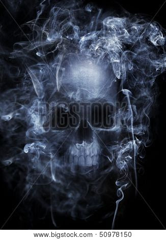 Photo montage of a human skull surrounded by cigarette smoke.