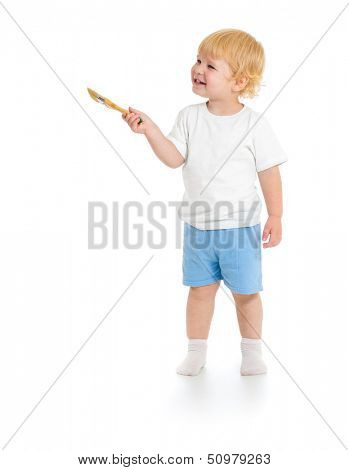 Baby boy with paint brush front view standing full length isolated on white background