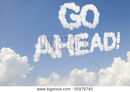 Go ahead concept text in clouds on blue sky