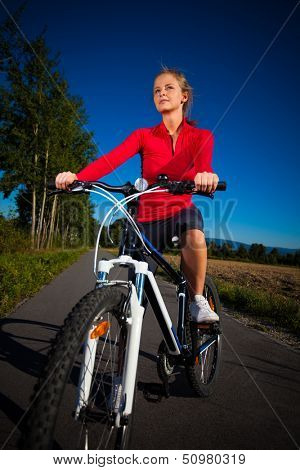 Healthy lifestyle - young woman biking