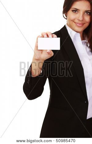 Businesswoman holding blank businesscard, focus on card, isolated