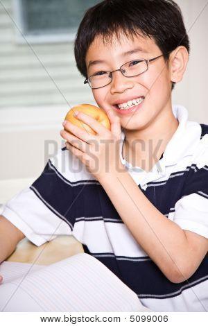 Studying Kid Eating Apple