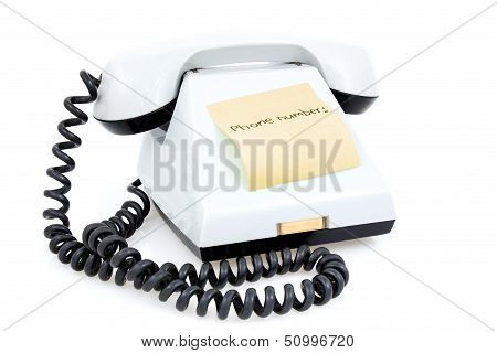 White Telephone With Sticky Note