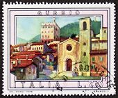 ITALY �?�¢?? CIRCA 1978 a stamp printed in Italy shows an illustration of Gubbio, medieval town i
