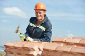 stock photo of putty  - Portrait of construction mason worker bricklayer with trowel putty knife outdoors at building area - JPG
