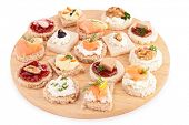 stock photo of canapes  - isolated assortment of canape - JPG