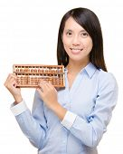 Asian woman holding abacus