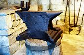 image of blacksmith shop  - Medieval iron Anvil in a blacksmiths shop - JPG