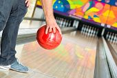 stock photo of bowling ball  - Young man in bowling alley having fun - JPG