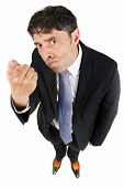 Humorous high angle portrait of a man in a business suit pointing a finger in accusation and blame w