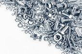 stock photo of bolt  - Chrome nuts and bolts closeup - JPG