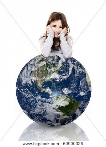 Little girl resting with her arms over a small planet earth, isolated on white background - Image of planet provided by Nasa