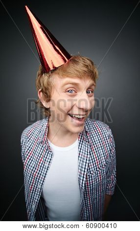 Portrait of cheerful guy at fools day celebration looking at camera with a smile