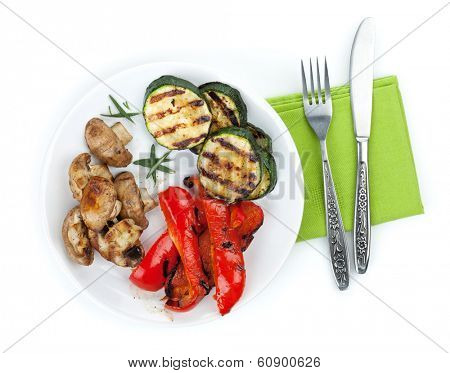 Grilled vegetables on plate. Isolated on white background