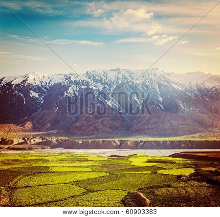 Vintage retro hipster style travel image of Spiti Valley -  snowcapped Himalayan Mountains. Himachal Pradesh, India