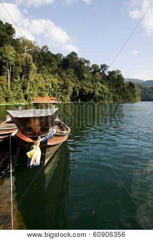 Wooden boats in ratchaprapa Dam,Khao Sok,Thailand