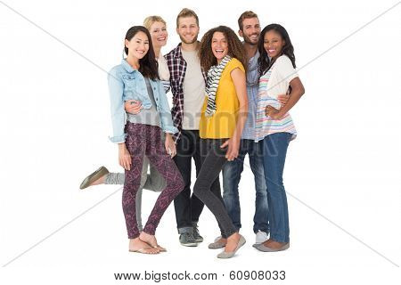 Happy group of young friends smiling at camera on white background