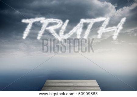 The word truth against cloudy sky over ocean