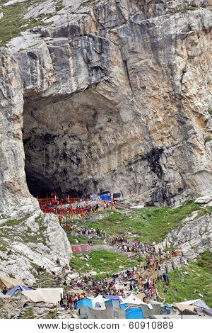 AMARNATH, JAMMU & KASHMIR, INDIA - JULY 18, 2006: Holy Amarnath Cave in Kashmir Himalays. It is a Hindu shrine dedicated to Shiva.  It is considered to be one of the holiest shrines in Hinduism.