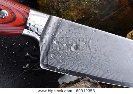 Knife and water drops close-up