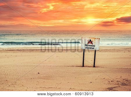No Camping Sign On The Beautiful Beach At Sunset. Cadiz, Southwestern Spain