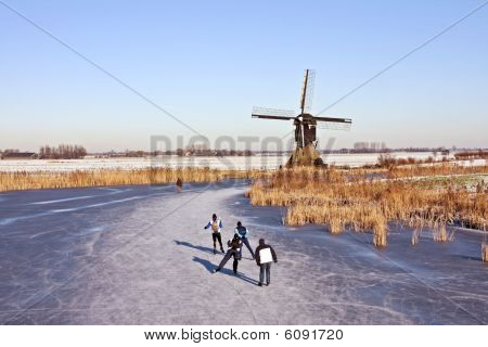 Typically dutch: ice skating on a cold winterday in the Netherlands