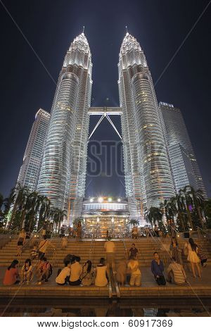 Tourists By Petronas Twin Towers At Night
