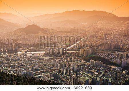 Busan, South Korea hazy sunset skyline.