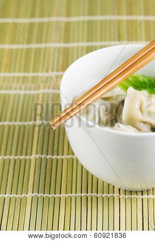 Bowl Of Wonton On Natural Bamboo Place Mat