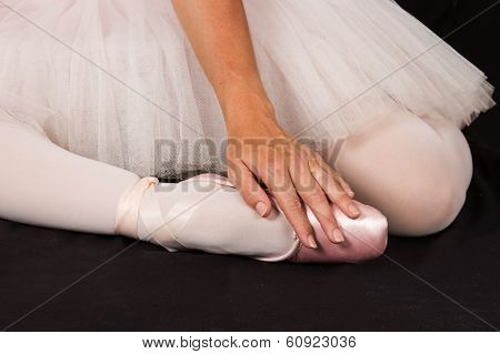 Ballerina Sit Down On Floor To Put On Slippers With Hands For Perform