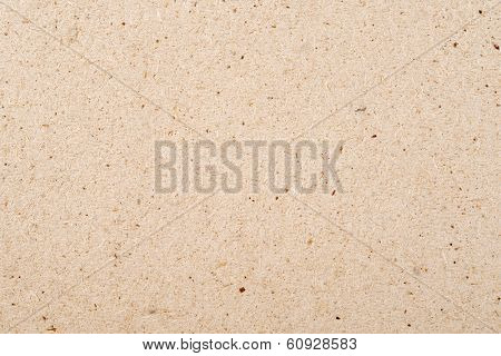 Pressed sawdust background, close up.