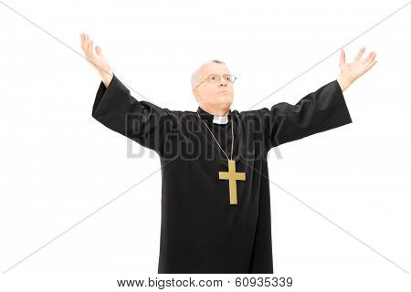 Priest in black mantle gesturing with hands isolated on white background