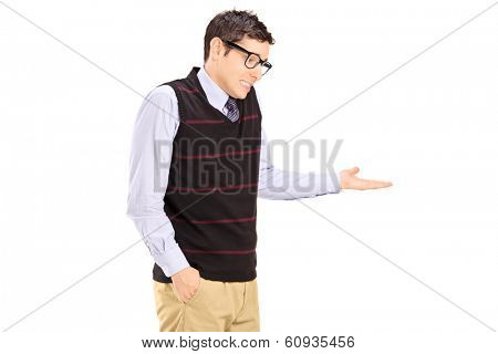 Uncertain young man gesturing with hand isolated on white background