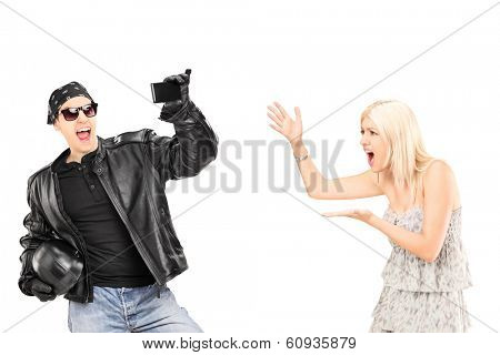 Mad woman yelling at her biker boyfriend isolated on white background