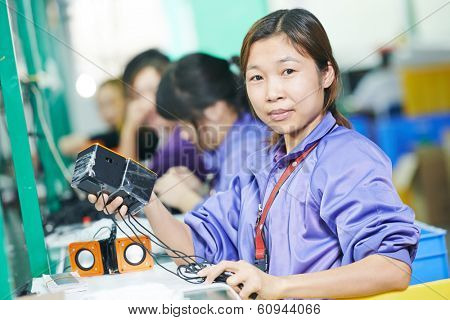 one chinese worker assembling production at line conveyor in china factory