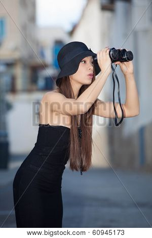 fashion model with binoculars