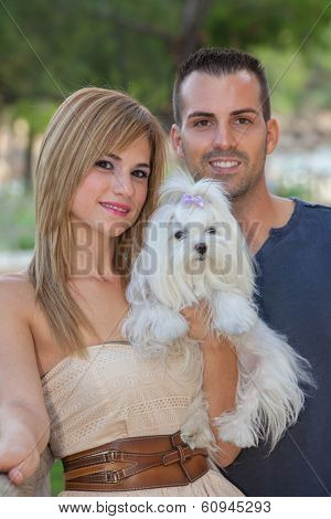 people with pet Maltese dog