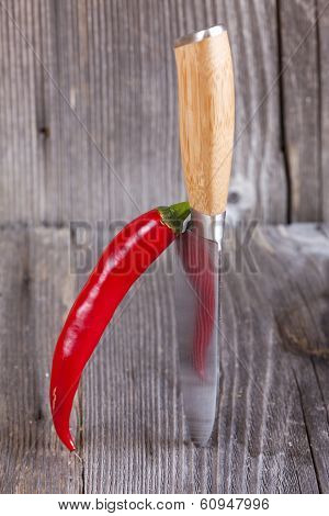 Piri Piri Chilli Pepper Stands Ajar Vertically On A Kitchen Knife