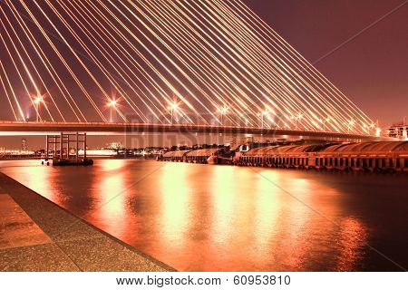 The Rama Viii Bridge Over The Chao Praya River At Night In Bangkok, Thailand