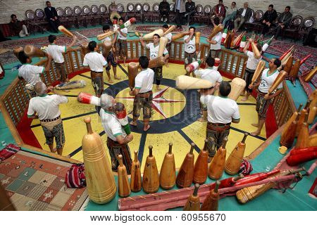 YAZD, IRAN - NOVEMBER 29, 2007: Pahlevani and zoorkhaneh rituals.Traditional Iranian system of athletics originally used to train warriors