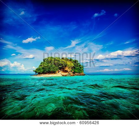 Vintage retro hipster style travel image of vacation holidays concept background - tropical island and long-tail boat in sea. Thailand
