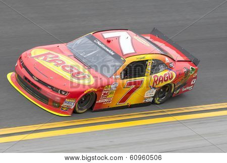 DAYTONA BEACH, FL - FEB 22, 2014:  Regan Smith (7) rest of the field to win the DRIVE4COPD 300 at Daytona International Speedway in Daytona Beach, FL.