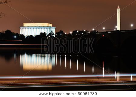 Washington DC - Lincoln Memorial and Washington Monument at night. A night view from riverside of the Potomac River