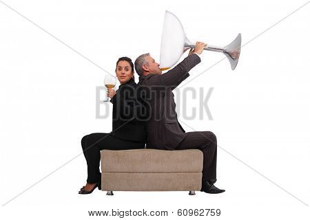 A brazilian couple just enjoying a little sip - Isolated on white background.