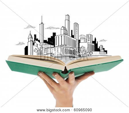 education and book concept - close up of woman hand holding open green book with city sketch