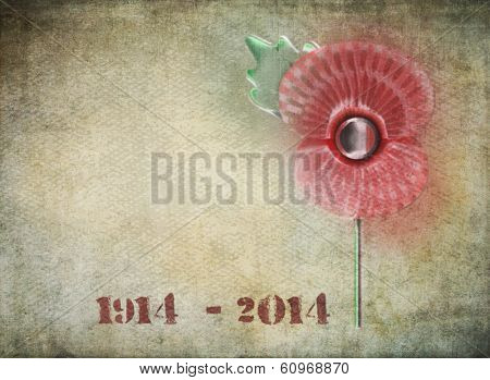 Graffiti style remembrance day poppy on grunge background. Dates on 1914-2014 in stencil style to commemorate the Centenary of World War One.