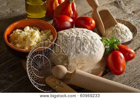 dough and ingredients for homemade pizza