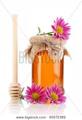 Sweet honey in jar with drizzler isolated on white