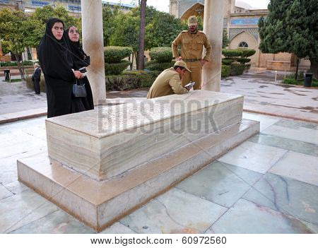 SHIRAZ, IRAN �¢�?�? NOVEMBER 26, 2007 �¢�?�? Iranian military servicemen with their wives visiting the Tomb of Persian poet Hafez in Shiraz. Hafez is supposed to be one of the most famous poets in Iran