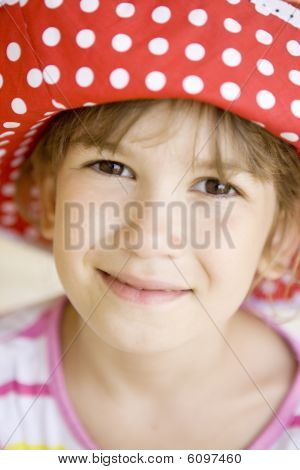 funny girl in spot red panama